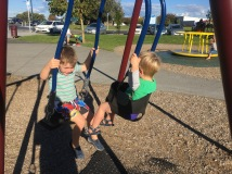 The brothers on a partner swing together.