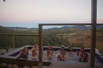 Group shot in the hot tub overlooking the valley